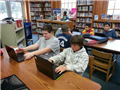 Students in Library regularly use Chromebooks to conduct research that links to what they're doing in their classroom