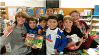 Students pooled their money together to buy a pack of books to share!